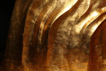 ironworks: Golden texture on black background