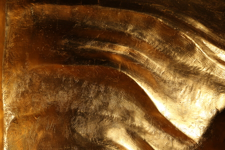 ironworks: Scratched gold. Close up Stock Photo