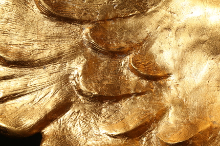 ironworks: Scratched golden covering