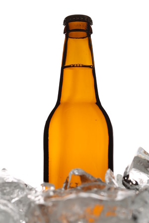 Bottle of ale in ice. Close up. White background