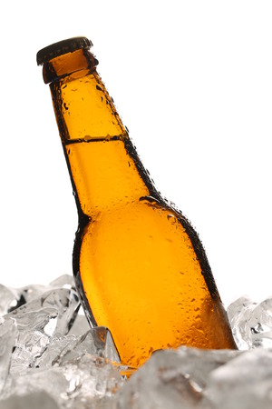 Bottle of malt in ice. Close up. White background