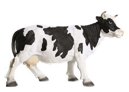 Black and white cow figurine. White background Redactioneel