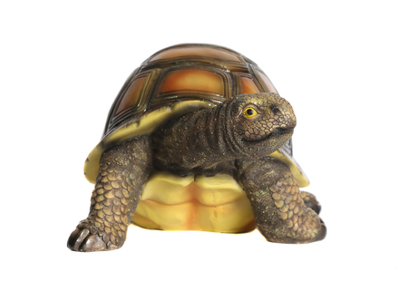 Turtle figurine. White background