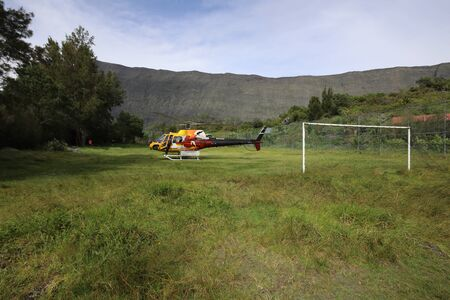 Reunion may 5, 2018: Football field in the mountains where a helicopter lands