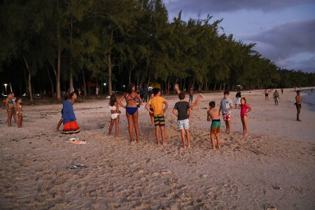Mauritius may 9, 2018: Children play on the beach near the sea