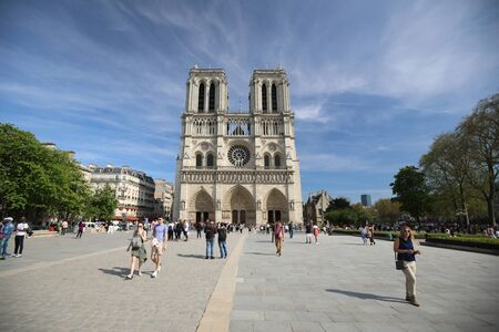 PARIS may 5, 2018: Cathedral of Notre Dame and many tourists are walking nearby