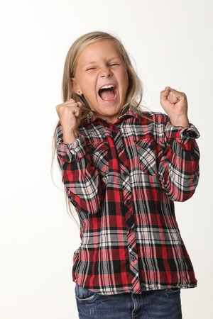 Portrait of a girl with long blond hair who laughs. White background Banque d'images