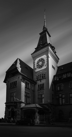 Town hall of Genevas Eaux-Vives quarter with its clock tower. In black and white color
