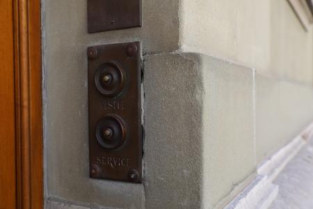 Vintage doorbell on a house in geneva