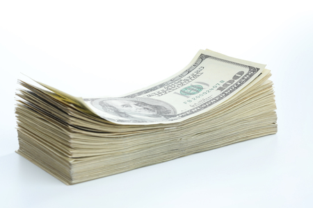 Many dollar banknotes on white background. National American currency