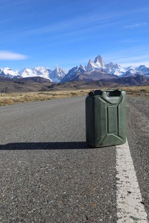 Gas canister on the road against the backdrop of the mountains