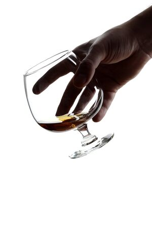 Male hand holding a glass of brandy isolated on white background 版權商用圖片