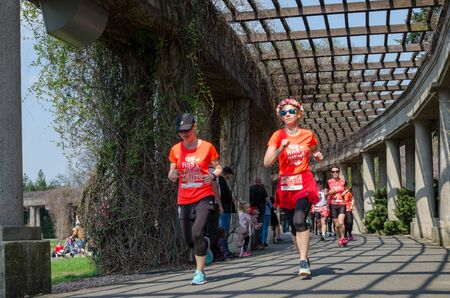 Few women in t-shirts with numbers. Marathon in the park in spring. Wroclaw, Poland - April 7, 2019 新聞圖片