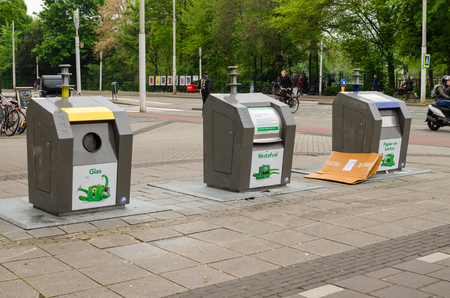 Amsterdam, Netherlands - May 03 2019: Three garbage containers for segregation on the street.