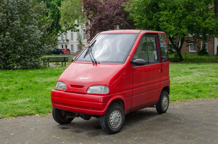 Amsterdam, Netherlands - May 03 2019: Small red car for two persons. Canta LX.