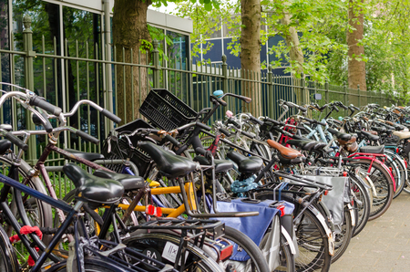 Amsterdam, Netherlands - May 03 2019: A lot of bicycles in line on the bike parking.