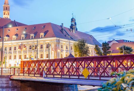 WROCLAW, POLAND - August 05, 2019: Nightview of the Most Piaskowy the Red Bridge against The Ossolineum or the National Ossoli?ski Institute in Wroclaw, Silesia, Poland