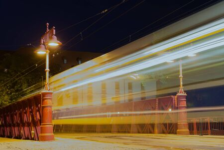 WROCLAW, POLAND - August 05, 2019: Nightview of the Most Piaskowy the Red Bridge with moving tram traces in Wroclaw, Silesia, Poland