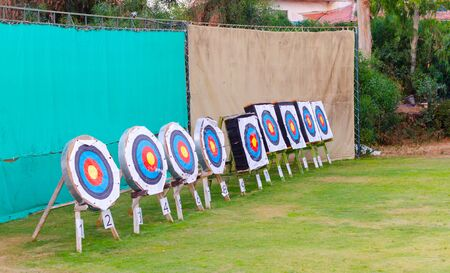 Used targets for archery standing outside.