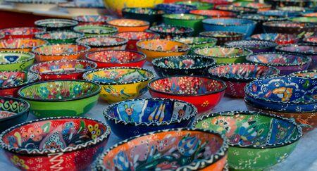 Turkish handmade colorful ceramic plates and bowls. Close up.