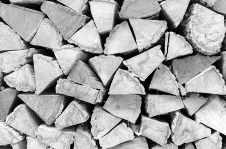 Background, texture of the wall from the folded logs. Black and white. High contrast