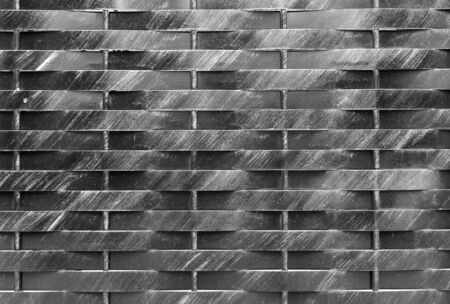 Old black and white metal wall background. Horisontal and vertical lines gate. City or rural rtexture. Dark geometric wallpaper 版權商用圖片