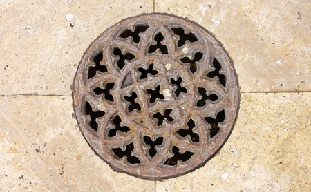 Cover of a manhole near Cathedral of St. Michael photo