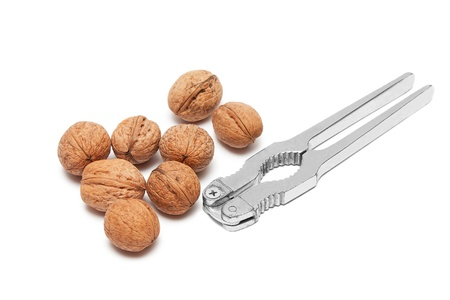 Walnuts and nutcracker isolated on white photo