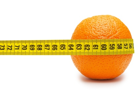 Orange and tape measure isolated on white photo