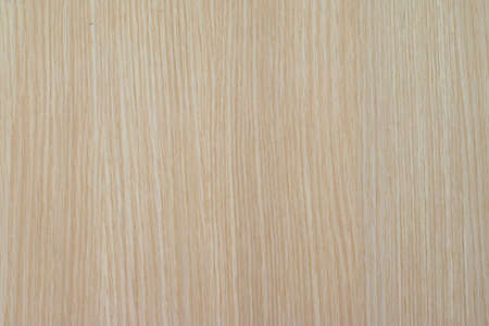 Closeup of rough brown color natural light wood detail texture background surface in a vertical line. Copy space for texting and designing in exterior and interior furniture constructing industry
