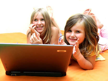 Two girls and laptop Stock Photo