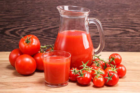 decanter: Tomato juice in a decanter and fresh tomatoes