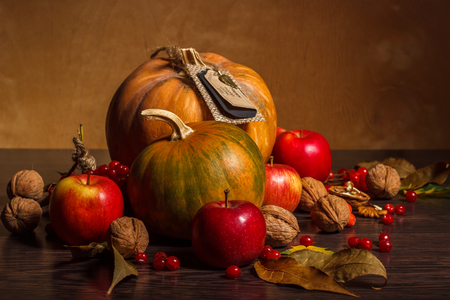 thanksgiving background: pumpkin and red apple on Thanksgiving Day on the wooden background Stock Photo