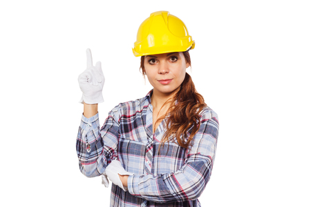 craftswoman: Young woman in yellow construction helmet on a white background shows up right thumb