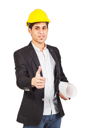 closed fist: Worker in a construction helmet with an architectural drawing shows thumb upwards from a closed fist, isolated Stock Photo