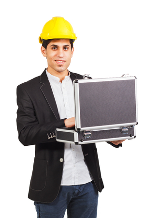 diplomat: Young man in a construction helmet with the diplomat in his hands on the white background