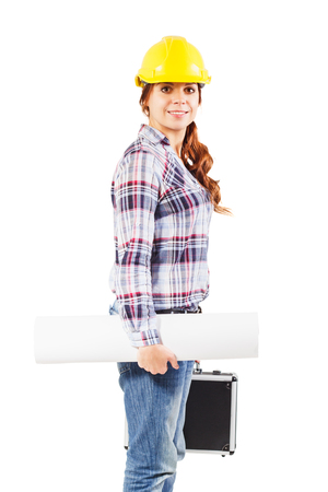 Young girl worker in a construction helmet with a blueprint and diplomat in the hands by the right side, isolated