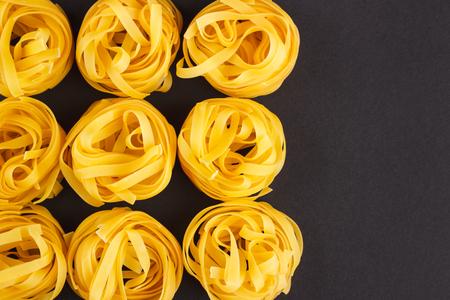 identical: Set of identical pasta on the black background Stock Photo
