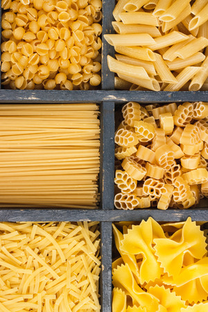 typesetter: Set of different types of pasta in the vintage wooden typesetter case with dividers Stock Photo