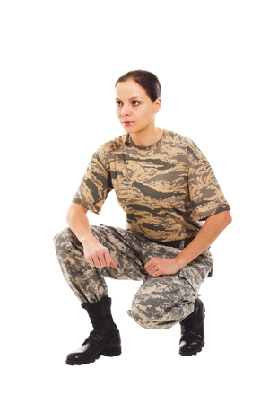 t short: Young girl-soldier in the camouflage military uniform turned to side Stock Photo