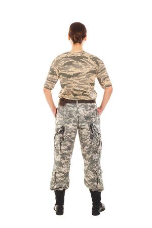 t short: Young girl-soldier in the camouflage military uniform standing by the front Stock Photo