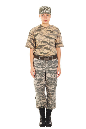 t short: Young girl-soldier in the camouflage military uniform and hat standing by the front