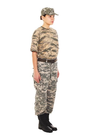 t short: Young girl-soldier in the camouflage military uniform and hat, standing by the front Stock Photo
