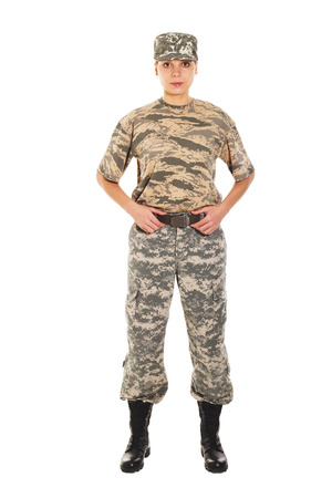 enduring: Young girl soldiers in camouflage military uniform and hat, holds by the belt