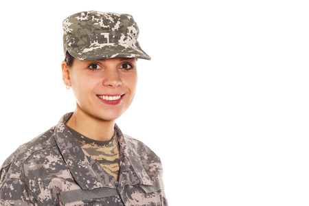 t short: Young smiling girl-soldier in the camouflage military uniform