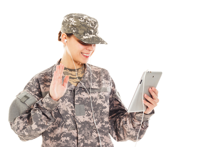 t short: Young smiling girl-soldier in the camouflage military uniform holds tablet Stock Photo