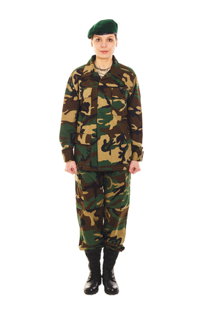 t short: Young girl-soldier in the camouflage military uniform and a beret stands by the front