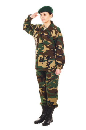 corporal: Soldier girl in the camouflage military uniform and beret greets someone