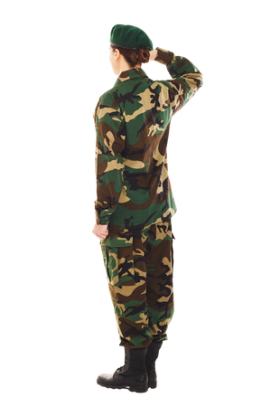 corporal: Soldier in the camouflage military uniform and beret greets someone