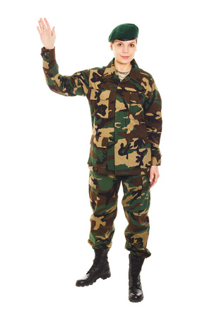 lieutenant: Soldier in the camouflage military uniform and beret waves by the hand